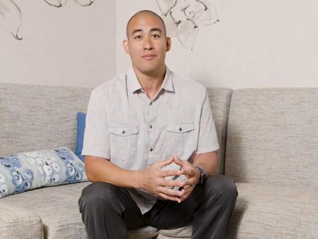 Man sitting on a couch.